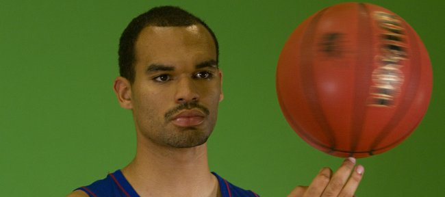 Kansas University sophomore Perry Ellis spins a basketball during a video shoot on KU men's basketball media day, Wednesday, Sept. 25, 2013, at Allen Fieldhouse.