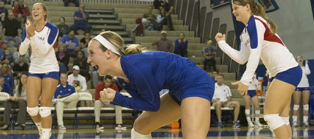 Kansas senior libero Brianne Riley celebrates a point with teammates during their volleyball match against TCU Saturday afternoon at the Horejsi Center.