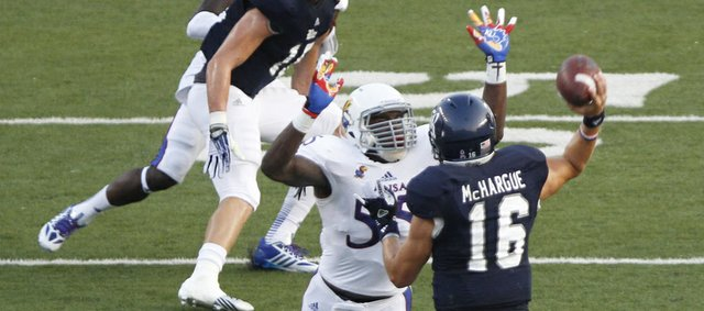 Kansas buck Michael Reynolds pressures Rice quarterback Taylor McHargue during the first quarter on Saturday, Sept. 14, 2013 at Rice Stadium in Houston, Texas.