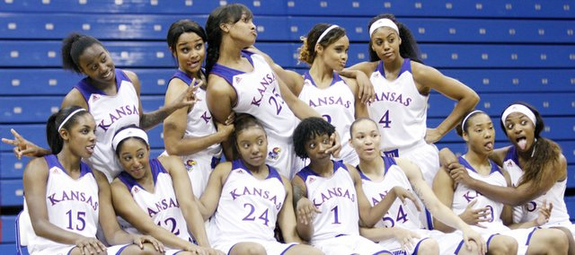 The Kansas women's basketball team makes a funny pose during team photographs during the KU women's basketball team media day Wednesday at Allen Field House.