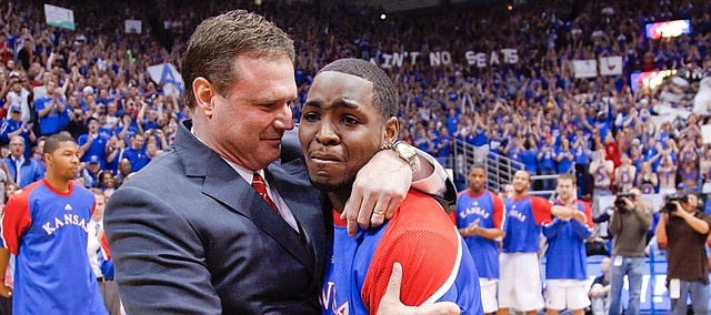 Kansas senior point guard Sherron Collins gets an emotional hug from head coach Bill Self as he is honored by the Allen Fieldhouse crowd before tipping off against Kansas State, Wednesday, March 3, 2010.