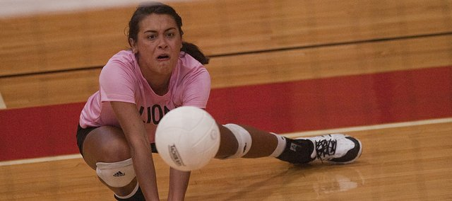 LHS senior Caitlin Broadwell (5) gets low for a return against the Maize Eagles on Saturday October 5, 2013.