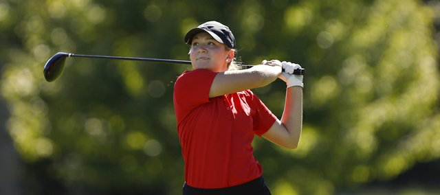Lawrence High senior Campbell Drake watches her drive on the 18th hole during the Free State Invitational on Monday, Oct. 7, 2013 at Lawrence Country Club.