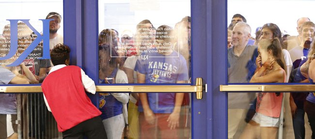 Kansas fans unable to enter pile up at an entrance on the north side of Allen Fieldhouse after the maximum amount had been let in for Late Night in the Phog, Friday, Oct. 4, 2013 at Allen Fieldhouse.