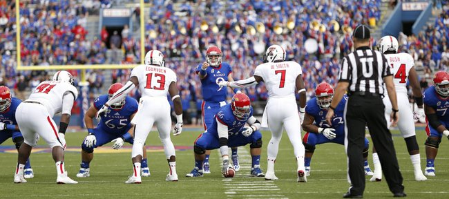 Kansas quarterback Jake Heaps runs the offense against Texas Tech during the first quarter on Saturday, Oct. 5, 2013 at Memorial Stadium.