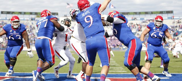 Kansas quarterback Jake Heaps throws out of the Jayhawks endzone against Texas Tech during the third quarter on Saturday, Oct. 5, 2013 at Memorial Stadium.