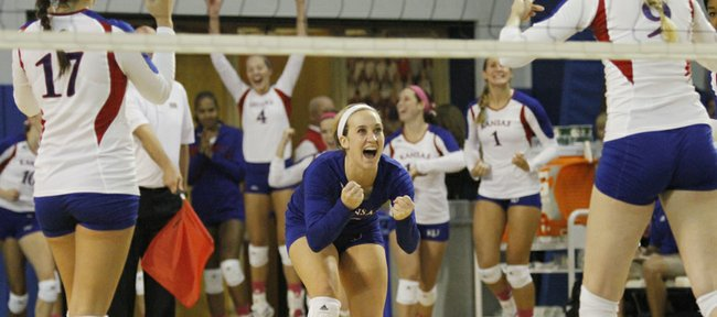 Kansas' Brianne Riley (3) celebrates with Erin McNorton, (17), left, and  Caroline Jarmoc (9) right, after a kill gave KU a come from behind win in a game against the Oklahoma Sooners Wednesday at the Horejsi Center.