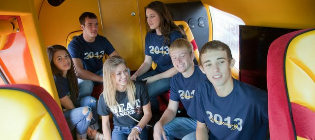 Perry-Lecompton high school students and members of the school's homecoming royal court, got a ride inside the Oscar Mayer Wienermobile and taken to lunch at Panera Bread, 520 W 23rd St, in Lawrence Friday. Tonight two of the students will be selected king and queen for homecoming. From left are Annie Mehl, Brandon Eddy, Emma Taylor, Taylor Fuller, Austin Johanning and Zach Linguist.