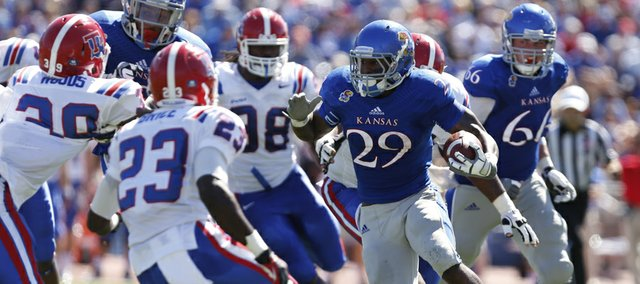 Kansas running back James Sims looks for yardage deep in Louisiana Tech territory during the second quarter on Saturday, Sept. 21, 2013 at Memorial Stadium.