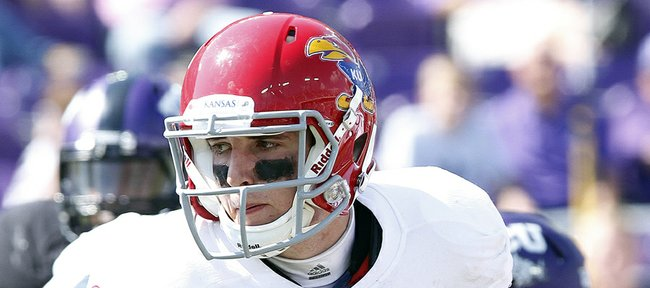Kansas quarterback Jake Heaps looks for a hand off against TCU on Saturday, Oct. 12, 2013. KU lost, 27-17.