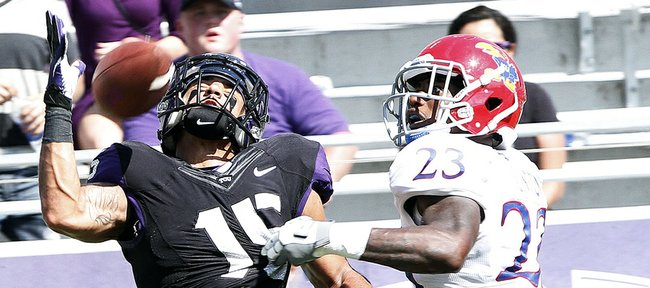 Kansas safety Dexter Linton (23) breaks up a pass intended for TCU's Cameron Echols-Luper (15) on Saturday, Oct. 12, 2013. KU lost, 27-17.