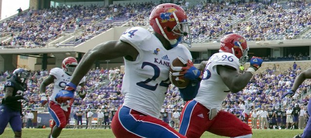 Kansas cornerback JaCorey Shepherd (24) takes a interception in for a KU touchdown against TCU on Saturday,  Oct. 12, 2013.