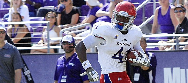 Kansas tight end Jimmay Mundine (41) eludes TCU's Sam Carter (17) for a touchdown in the second half of TCU's 27-17 victory over KU on Oct. 12, 2013.