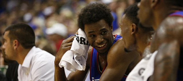 Kansas forward Andrew Wiggins laughs with his teammates on the bench during the Jayhawks' Late Night scrimmage, Friday, Oct. 4, 2013 at Allen Fieldhouse.