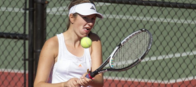 Free State High's Caitlin Dodd hits the ball during doubles action at a Class 6A regional tennis tournament, Saturday, Oct. 12, 2013, at Lawrence High.
