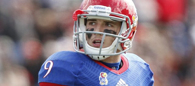 Kansas quarterback Jake Heaps looks at the scoreboard after coming off the field against Texas Tech during the third quarter on Saturday, Oct. 5, 2013 at Memorial Stadium.