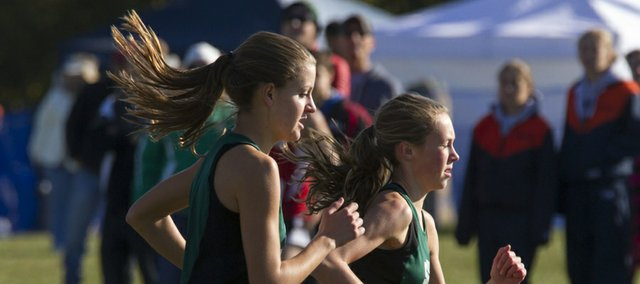 Free State's Emily Venters, right, and Bailey Sullivan compete in the Sunflower League Championship, Saturday at Rim Rock.