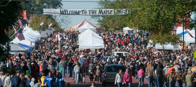 Richard Gwin/Journal World Photo. Sunshine prevailed and the band played as onlookers filed along the streets of the Maple Leaf Festival in Baldwin City on Saturday October 19, 2013. For more than 50 years the festival has been held the third week in October.