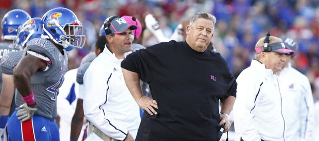 Kansas head coach Charlie Weis watches as a challenged fumble is ruled in favor of Oklahoma during the fourth quarter on Saturday, Oct. 19, 2013 at Memorial Stadium.