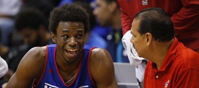 Kansas forward Andrew Wiggins laughs with assistant coach Kurtis Townsend during an open-practice scrimmage on