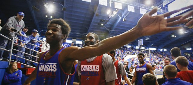 Kansas forward Andrew Wiggins reaches wide to slap hand with fans following an open-practice scrimmage on Saturday, Oct. 19, 2013 at Allen Fieldhouse.