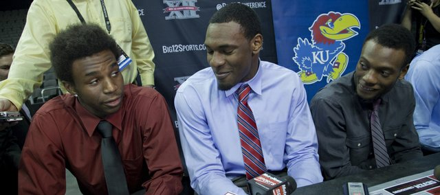 Kansas University freshman Andrew Wiggins, left, answers a question alongside senior Tarik Black, center, and junior Naadir Tharpe during Big 12 Men's Basketball Media Day on Tuesday, Oct. 22, 2013, at Sprint Center in Kansas City, Mo.