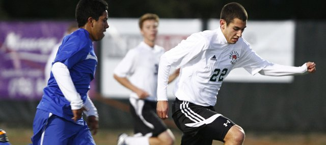 Free State senior midfielder PJ Budenbender takes off up the field against Leavenworth defender Eduardo Rodriguez during the first half on Tuesday, Oct. 22, 2013 at Free State High School.
