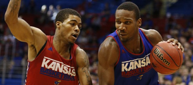 Blue Team guard Wayne Selden drives against Red Team guard Frank Mason during an open-practice scrimmage on Saturday, Oct. 19, 2013 at Allen Fieldhouse.