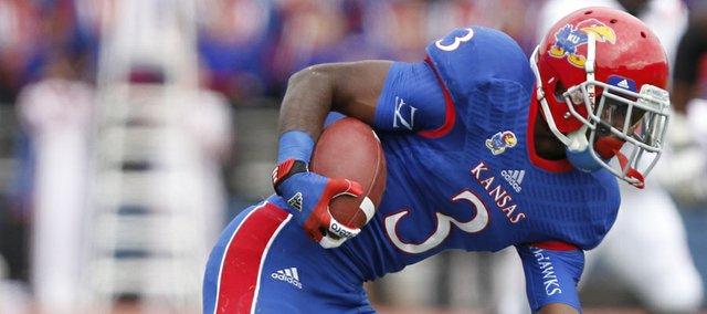 Kansas running back Tony Pierson shakes Texas Tech defensive back Bruce Jones during the first quarter on Saturday, Oct. 5, 2013 at Memorial Stadium.