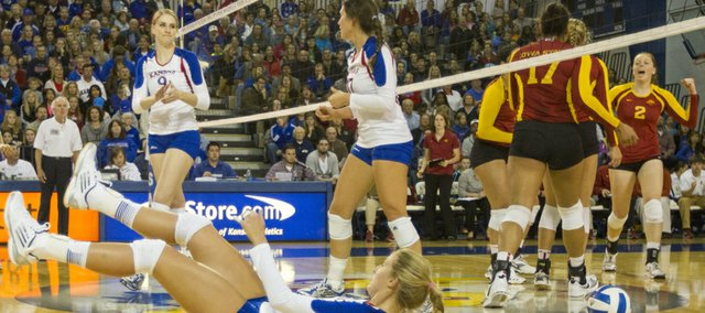 Iowa State players celebrate a point after Kansas' Chelsea Albers is unable to come up with the ball during their volleyball match Wednesday evening at the Horejsi Center.
