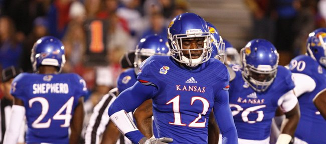 Kansas cornerback Dexter McDonald and the Kansas defense show their disappointment after giving up a touchdown to Baylor during the second quarter on Saturday, Oct. 26, 2013.