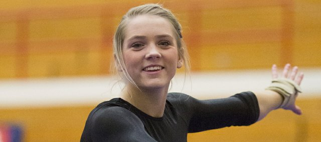 Free State junior Grace Bartle performs her floor routine during the state gymnastics championship Saturday, Oct. 26, 2013, at Olathe North High.
