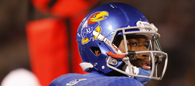 Kansas backup quarterback Montell Cozart watches the scoreboard against Baylor during the second quarter on Saturday, Oct. 26, 2013.