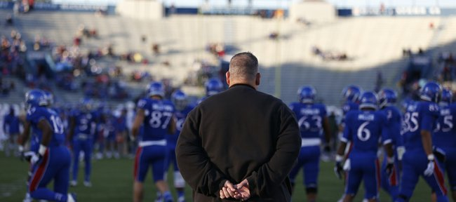 Kansas head coach Charlie Weis watches his team warm up for Baylor on Saturday, Oct. 26, 2013.