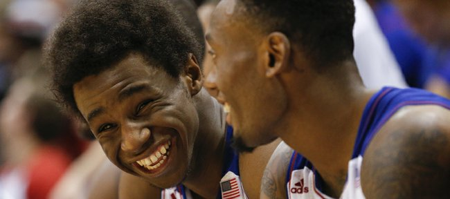 Kansas guards Andrew Wiggins, left, and Naadir Tharpe laugh on the bench during the second half of an exhibition game on Tuesday, Oct. 29, 2013 at Allen Fieldhouse.
