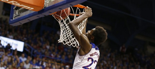 Kansas forward Andrew Wiggins delivers a dunk over Pittsburg State forward Trevor Gregory during the first half of an exhibition game on Tuesday, Oct. 29, 2013 at Allen Fieldhouse.