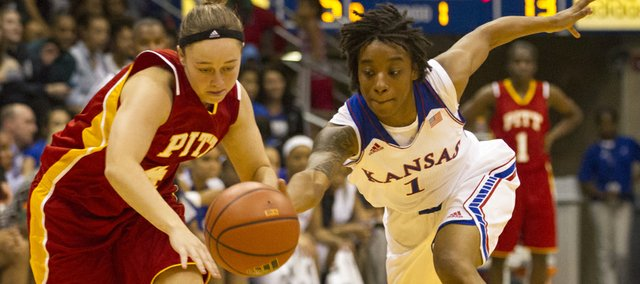 Kansas guard Lamaria Cole (1) swipes the ball away from Pittsburg State's Brigit Hesser (4) during their exhibition game Wednesday at Allen Fieldhouse.