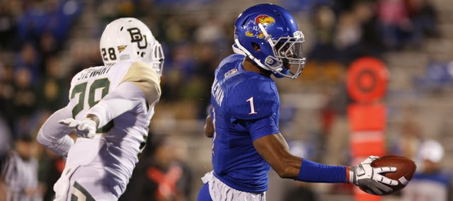 Kansas receiver Rod Coleman cruises into the endzone past Baylor safety Orion Stewart during the fourth quarter on Saturday, Oct. 26, 2013.
