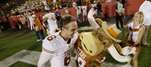 Texas quarterback Case McCoy celebrates with the team mascot after UT's 31-30 victory over Iowa State on Oct. 3 in Ames, Iowa. The Longhorns are undefeated since McCoy took over for the injured David Ash.