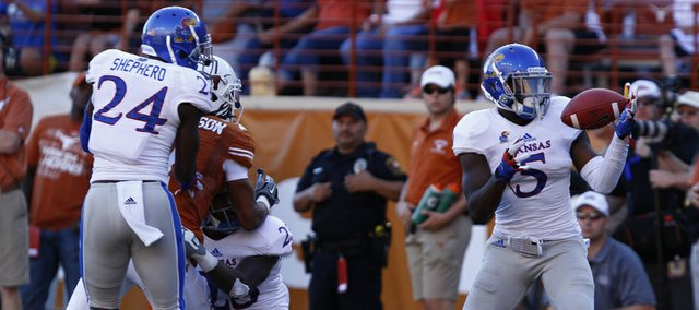 Kansas safety Isaiah Johnson comes away with his second interception of the game on a bobbled pass to a Texas receiver during the fourth quarter on Saturday, Nov. 2, 2013 at Darrell K. Royal Stadium in Austin, Texas.