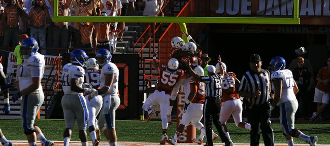 Texas players celebrate in the endzone with defensive tackle Chris Whaley after Whaley recovered a fumble by Kansas quarterback Jake Heaps and ran it back for a touchdown during the third quarter on Saturday, Nov. 2, 2013 at Darrell K. Royal Stadium in Austin, Texas.