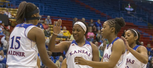 Kansas forward Chelsea Gardner (15) is congratulated by teammates after scoring while being fouled during their exhibition game against Emporia State, Sunday afternoon at Allen Fieldhouse. The Jayhawks downed the Hornets 61-53 in their final exhibition game of the season. Kansas opens its season next Sunday, Nov. 10, at home against Oral Roberts.