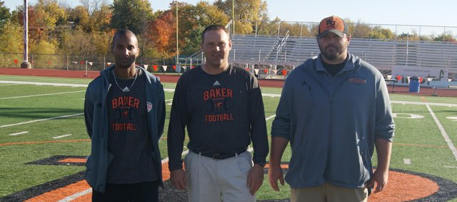 From left, former Kansas University football players Tony Blevins, Jason Thoren and Caleb Blakesley are now coaching just a short drive from Lawrence, at Baker University in Baldwin City.