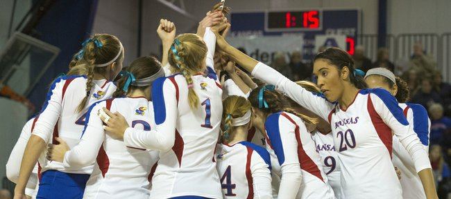 Senior Catherine Carmichael (20) and her Kansas University volleyball teammates come together before the start of their volleyball match against West Virginia, Wednesday, Nov. 6, 2013, at Horejsi Center.