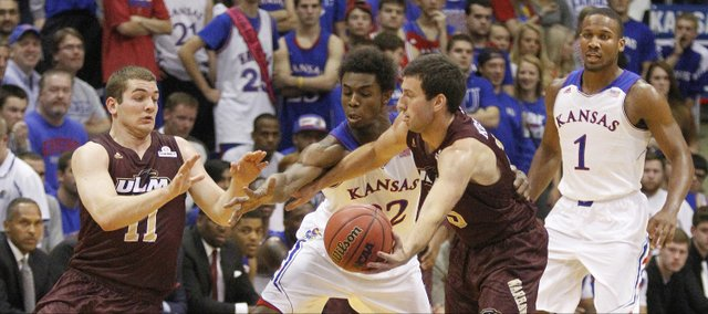 Kansas guard Andrew Wiggins (22) attempts a steal during the Jayhawks' regular-season opener against Louisiana Monroe, Friday, November, 8, 2013 at Allen Fieldhouse.