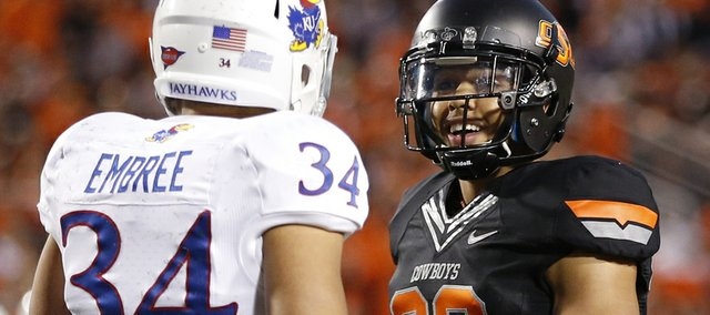 Former Kansas player and current Oklahoma State cornerback Tyler Patmon talks a little trash to Kansas' Connor Embree after an incomplete pass during the third quarter on Saturday, Nov. 9, 2013 at Boone Pickens Stadium in Stillwater, Oklahoma.