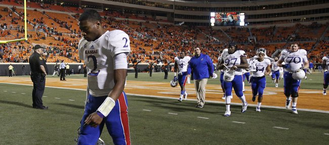 Kansas quarterback Montell Cozart hangs his head as he walks off the field following the Jayhawks' 42-6 loss to Oklahoma State on Saturday, Nov. 9, 2013 at Boone Pickens Stadium in Stillwater, Oklahoma.