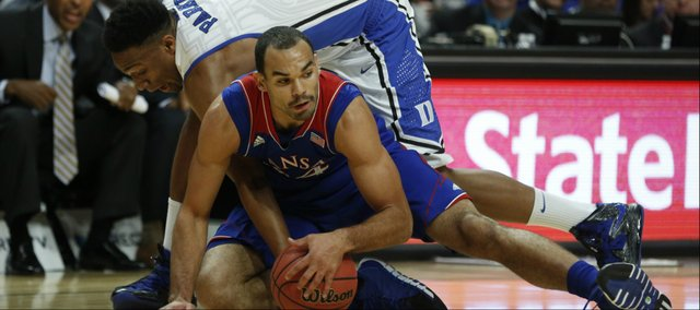 Kansas forward Perry Ellis wrestles for a loose ball with Duke forward Jabari Parker during the first half of the Champions Classic matchup on Tuesday, Nov. 12, 2013 at the United Center in Chicago.