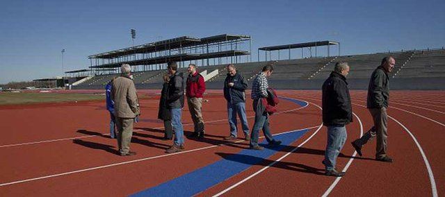 The Lawrence Parks and Recreation Advisory Board toured the Rock Chalk Park sports complex in northwest Lawrence on Tuesday. The running surface of the track and field stadium is installed.