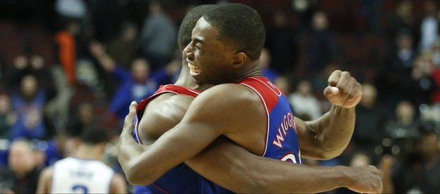 Kansas forward Andrew Wiggins hugs teammate Wayne Selden following the Jayhawks' 94-83 win over Duke during the Champions Classic matchup on Tuesday, Nov. 12, 2013 at the United Center in Chicago. At right is KU guard Frank Mason.
